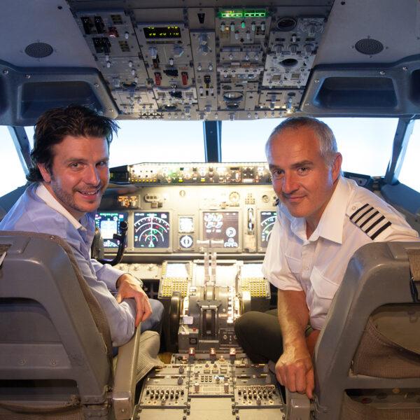 Man face camera 737 800 simulator cockpit behind