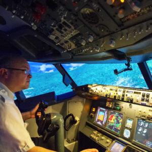 Man preparing to land 737 800 simulator