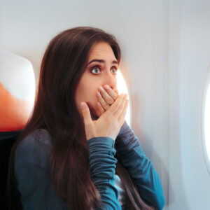 Lady is scared due to fear of flying sat in cabin