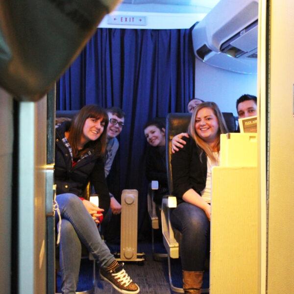 Group waiting their turn as pilot 737 800 simulator