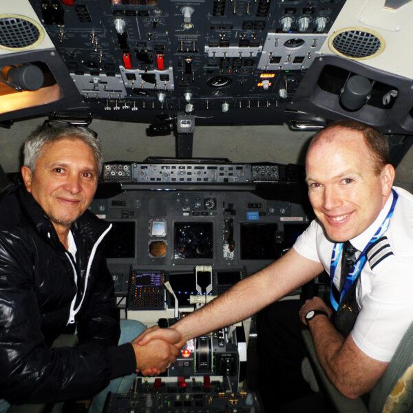 Pilots shakes customers hand 737 800 simulator