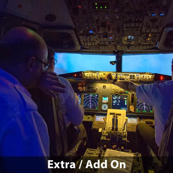 Three men in 737 800 simulator