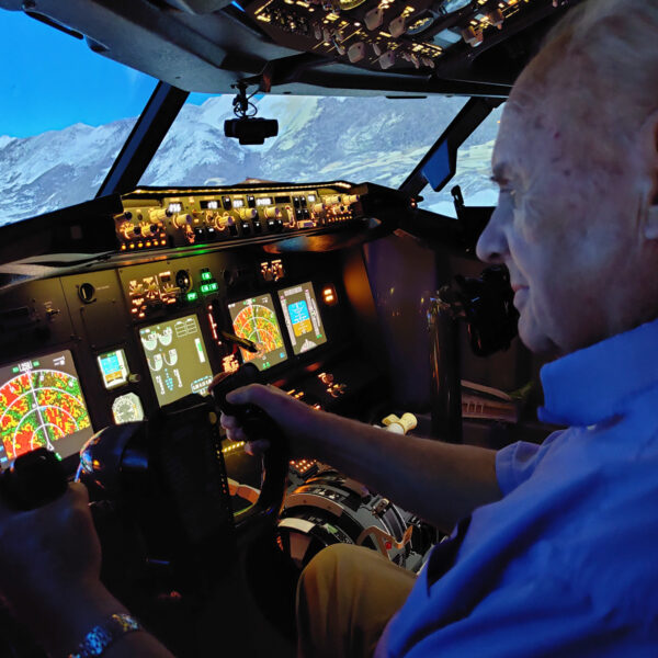 Man smiling in 737 800 Simulator