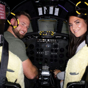Couple smiling in Vulcan Bomber Simulator