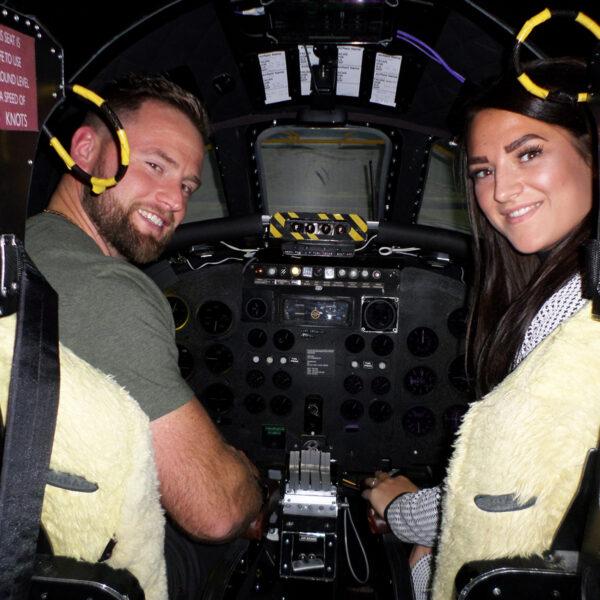 Couple smiling in Vulcan Bomber Simulator