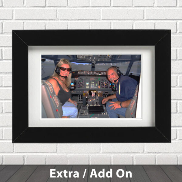 Photo of couple in 737 800 Simulator