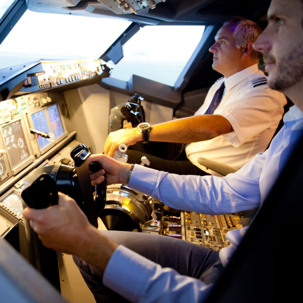 Pilot and customer concentrate in 737 800 simulator cockpit