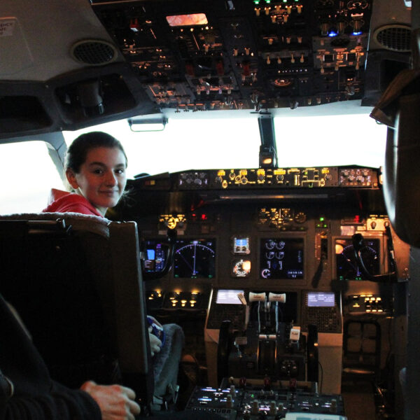 Teenager faces camera in 737 800 simulator