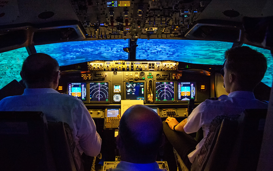 737 800 Simulator Three Men Flying