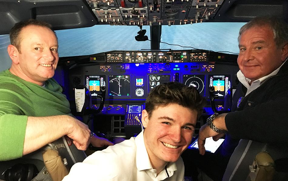 Three men in 737 800 Simulator Cockpit